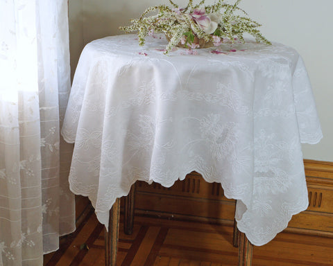 "52""x 52"" pure linen table topper. Hand embroidered with chain stitch and drawn work on fine quality of pure linen."