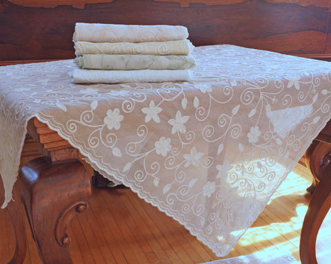 "42"" square embroidered cotton organdy tablecloth. Embellished with star like pattern."