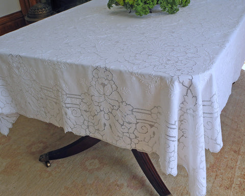 Pure linen dining tablecloth embellished with beautiful quality of drawn work style embroidery.