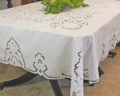Dining size tablecloth, hand embroidered on white linen using different styles of needlework.