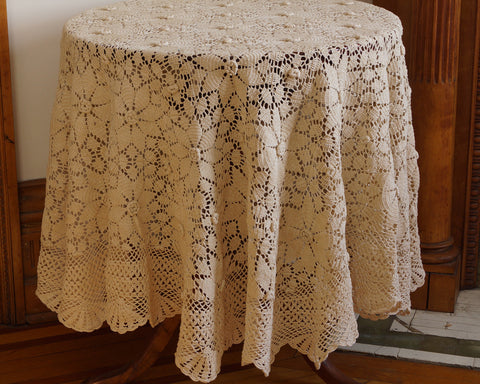 "Beautiful hand crochet, 68"" round tablecloth in lush cream color, featuring dimensional rosette design and scalloped edge."