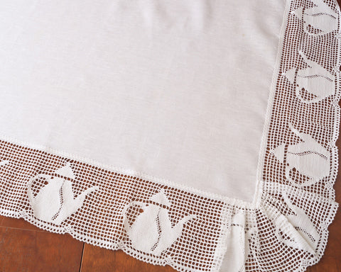 Table topper made in fine quality of Italian linen and edged with whimsical teapot lace.