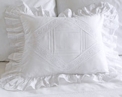 Boudoir pillow sham in white cotton decorated with vintage looking tucks and lace insets.