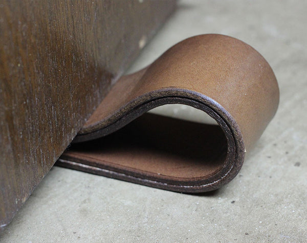 Black X's Leather Doorstop