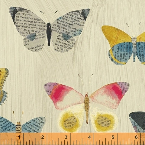 Newspaper Butterflies in Sand - Carrie Bloomston