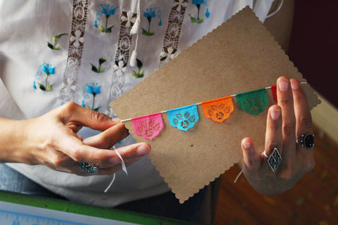 Artist Yreina Flores making papel picado