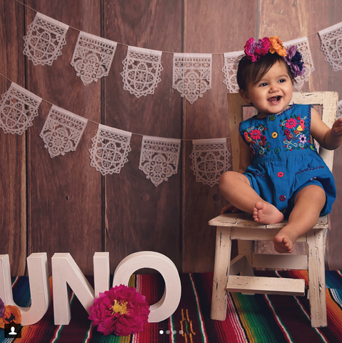 First birthday portrait with Ay Mujer papel picado