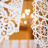 Chandelier and wedding papel picado by Ay Mujer