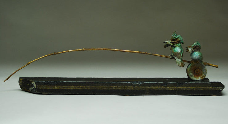 bronze sculpture of two king fishers