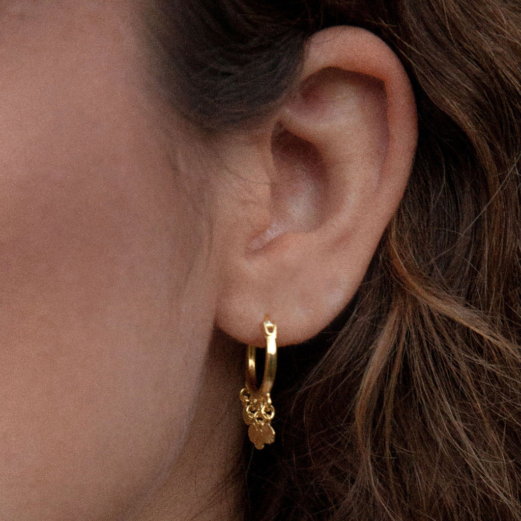 18 carat gold hoop earring with charm details