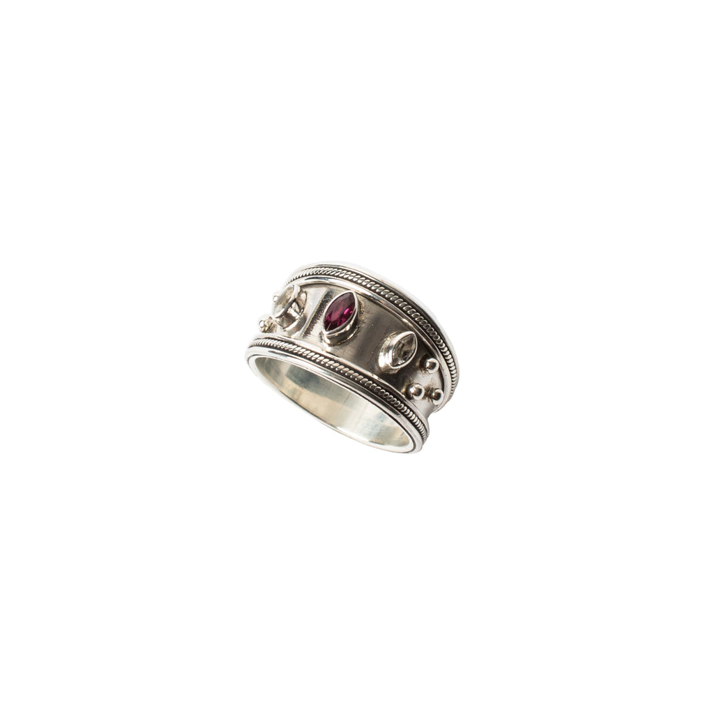 Rhodolite and white topaz ring set in a wide sterling silver band by wild heart jewellery