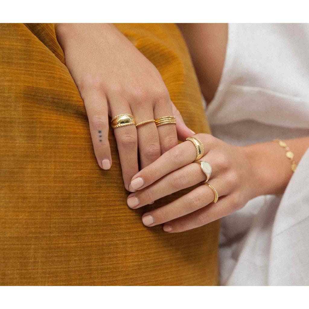 model wears gold set of 4 stack rings by wild heart jewellery