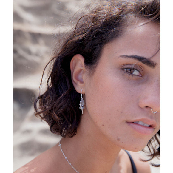 model wears sterling silver jolene earrings by wild heart jewellery