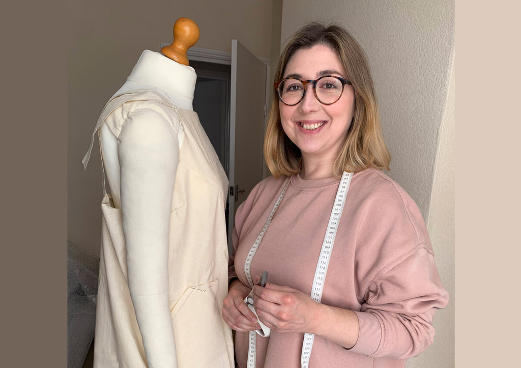 Klès designer maker Jessica Gomez next to a mannequin in her lockdown home studio