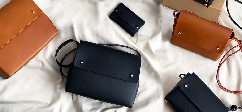 Folded leather bag collection