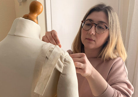 Klès designer maker Jessica Gomez working on a dress pattern on a mannequin
