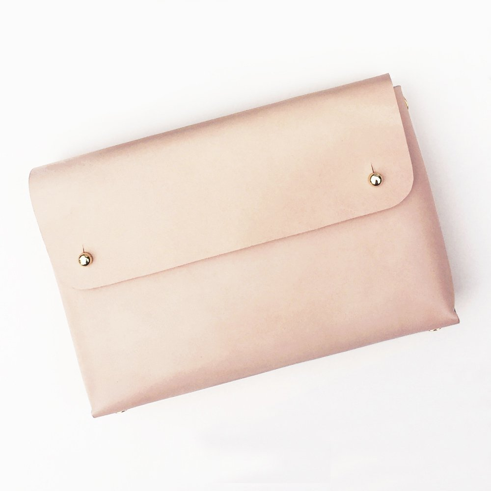 Leather pouch made of natural leather - front view on plain background