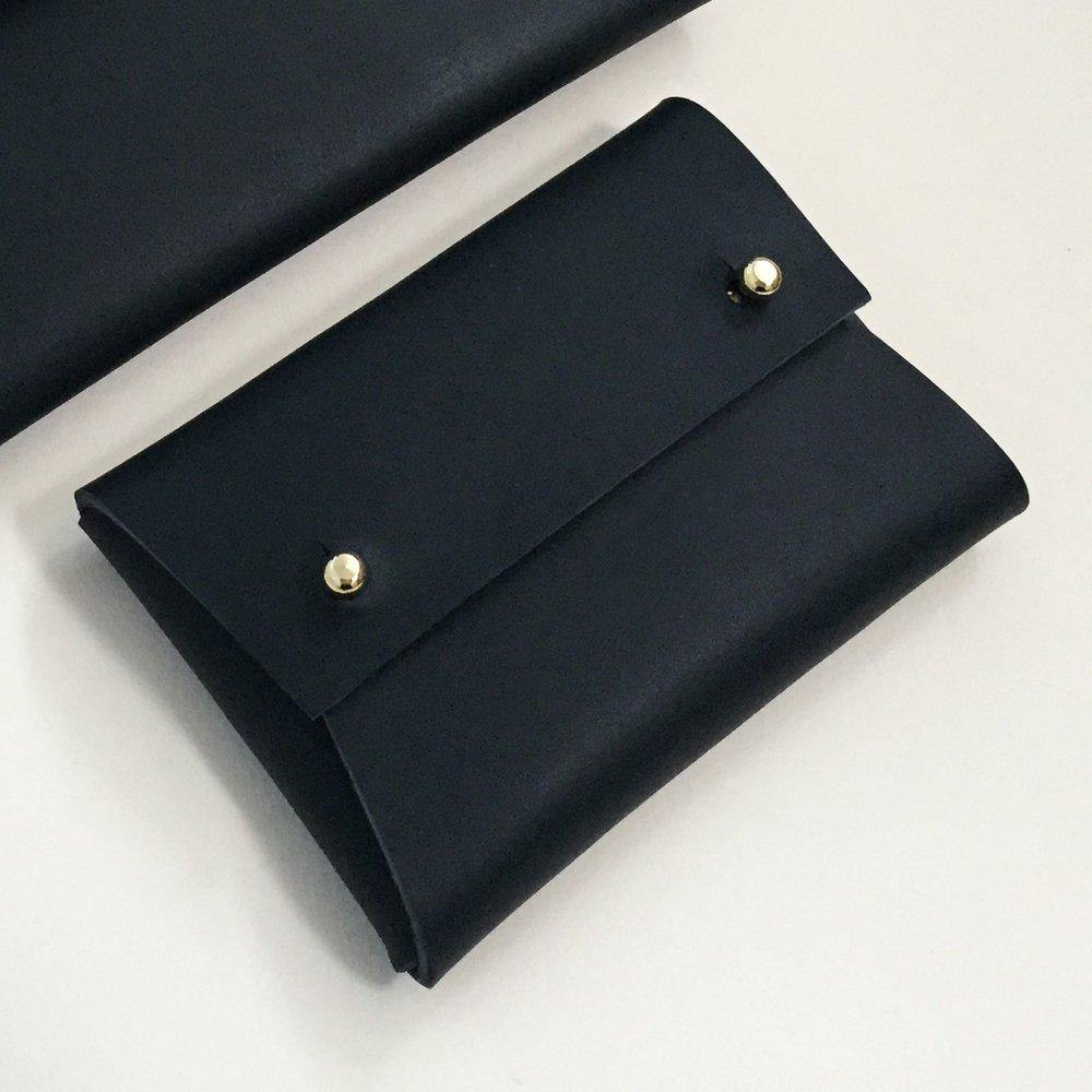 Minimalist leather card holder MILA on a plain background