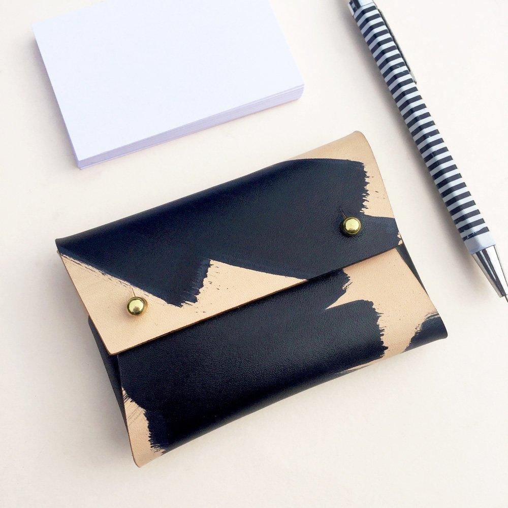 MILA Ink Brushed leather card wallet with business cards and a pen