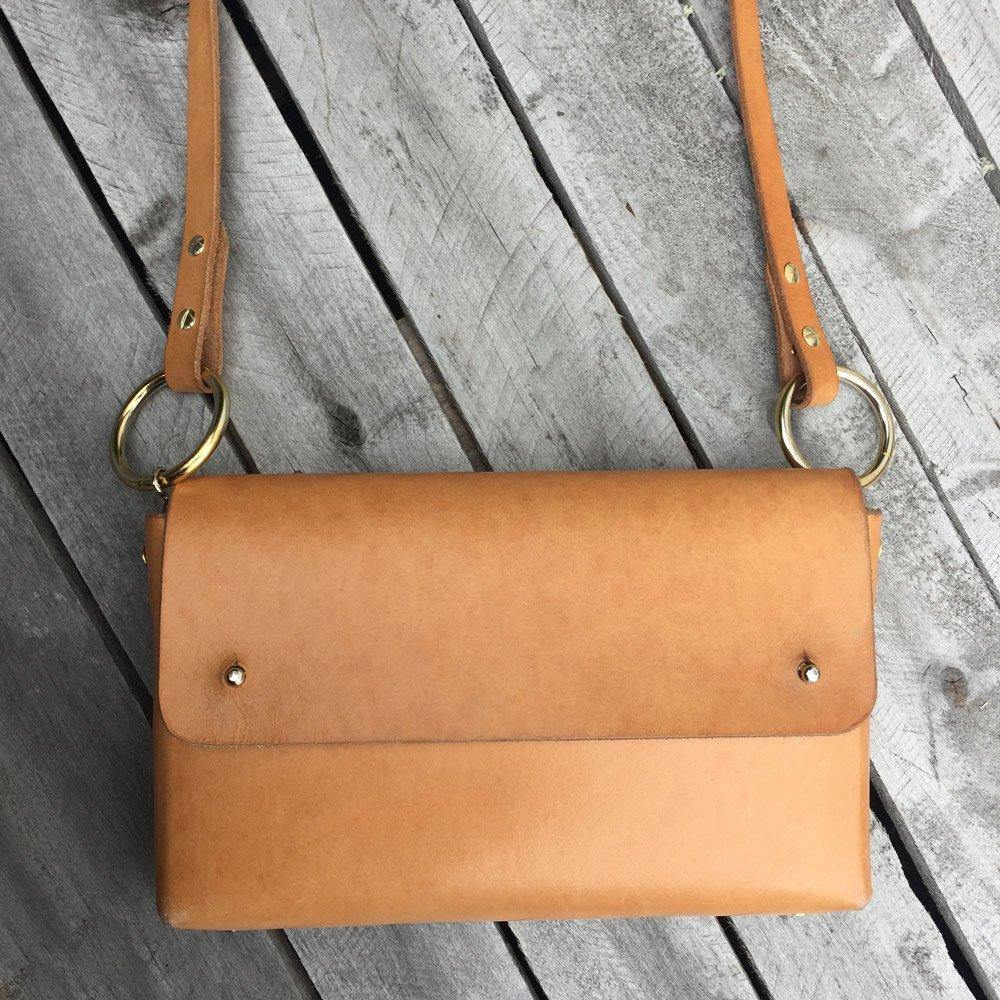 vegetable tanned leather bag with patina
