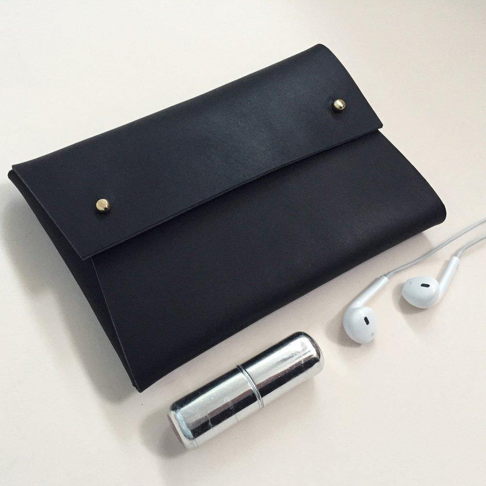 Matte Black Misha pouch on a plain background