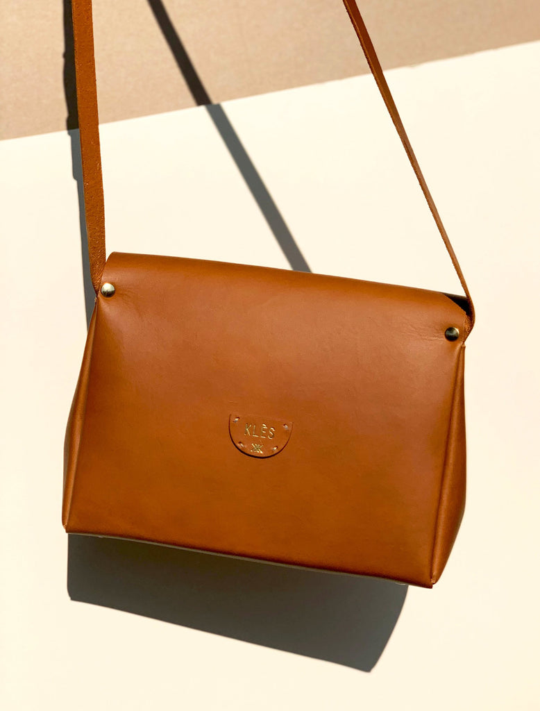 Tan leather handbag - back view