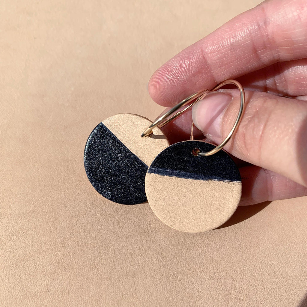 Leather earrings in hand