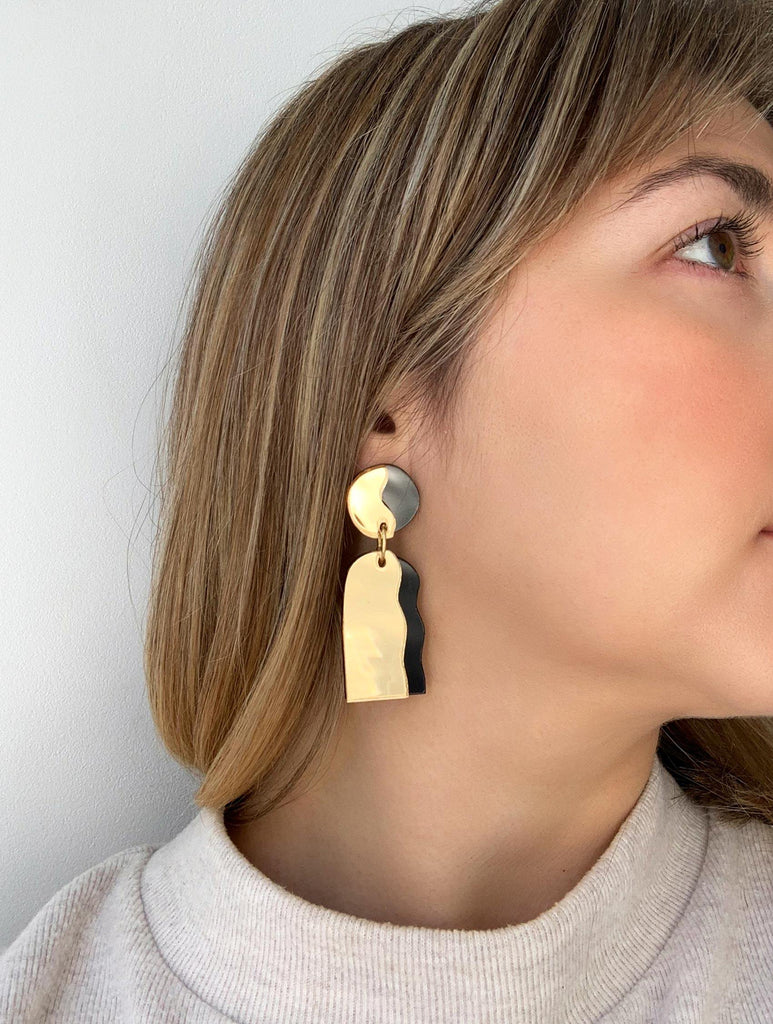 CELESTIA handmade statement earrings on a model - mirror gold and black