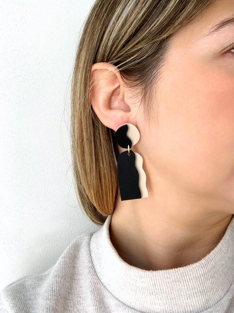 CELESTIA handmade statement earrings on model - matte nude and black