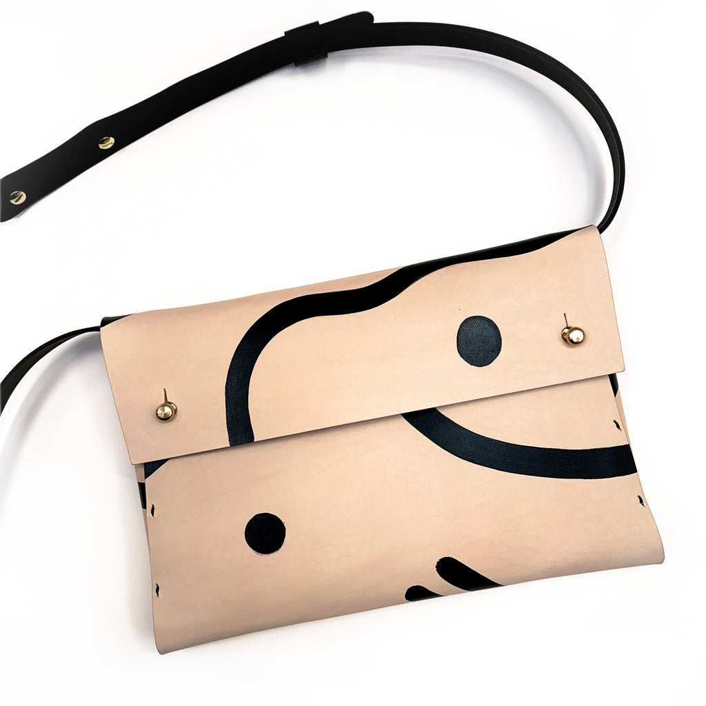 Handmade leather bag with a hand-painted monochrome pattern and removable strap