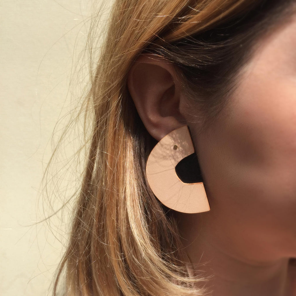 Handmade leather earrings on a model