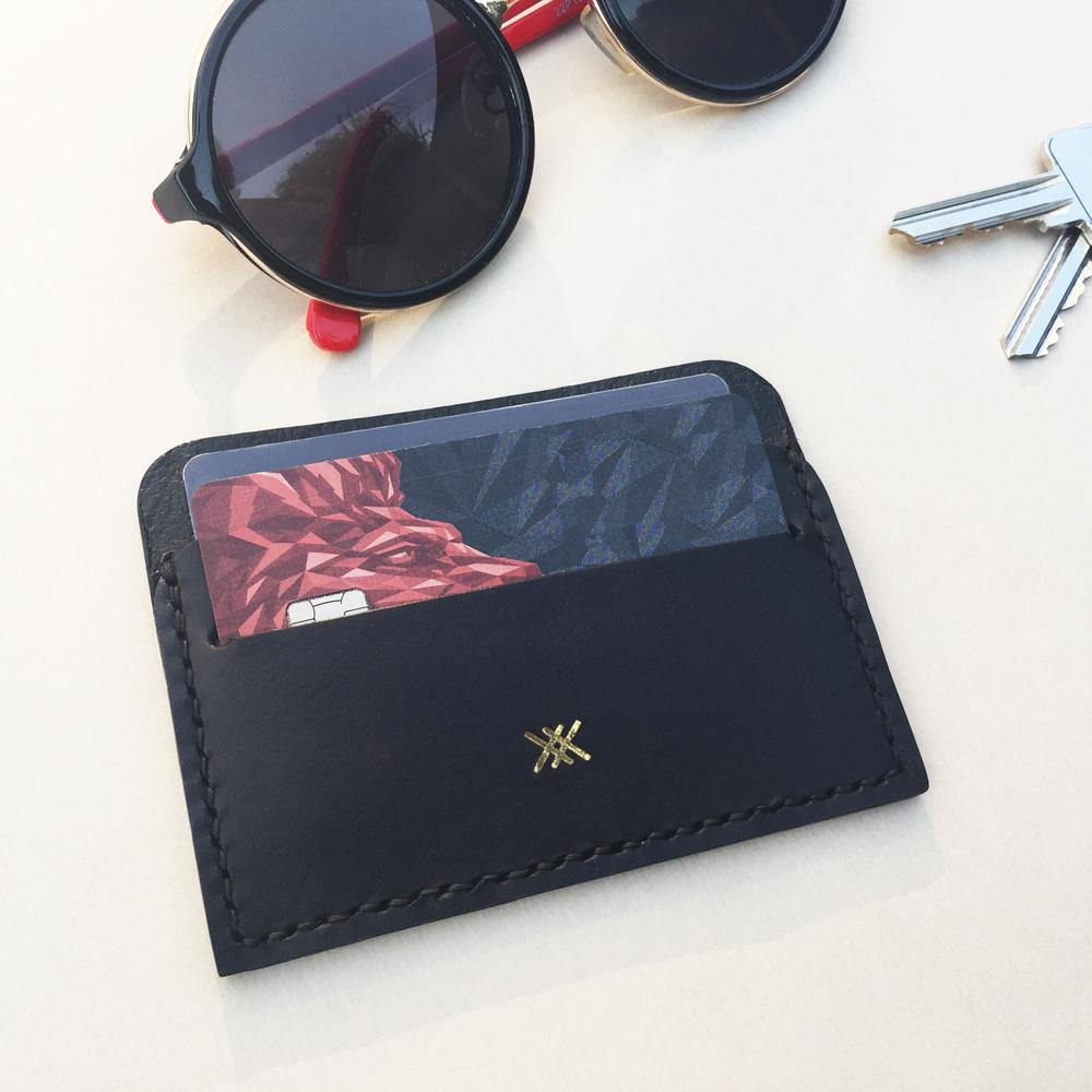 MIKA card holder with cards inside