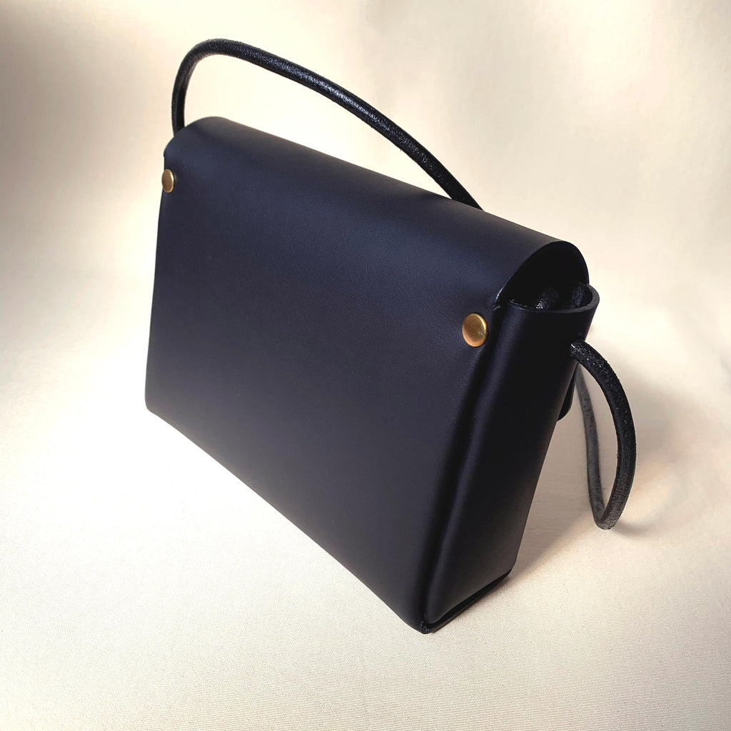 Handcrafted leather mini bag - back