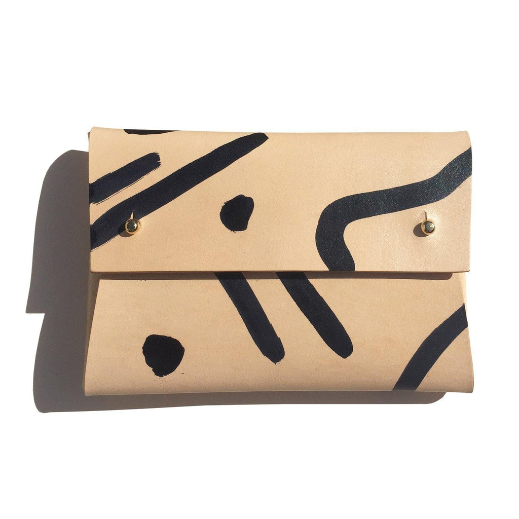 Misha hand-painted leather pouch on a plain white background