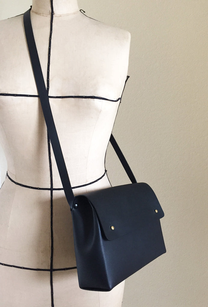 Handmade cross-body bag on a mannequin