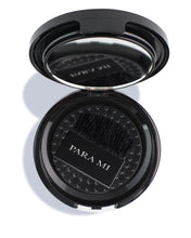 Load image into Gallery viewer, Mineral Bronzer, the lower layer of the compact shows the brush with PARA MI printed on the handle as well as a mirror on the upper part of the inner compact. Compact is semi opened showing the inside.