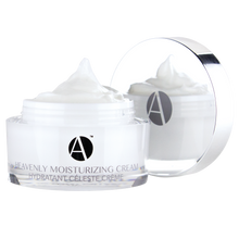 "Load image into Gallery viewer, ANJALI MD Heavenly Moisturizing Cream for Intense Non-Greasy Hydration. A white cream inside a white acrylic jar with the ""A"" logo in chrome. Features the product title printed in a light grey"