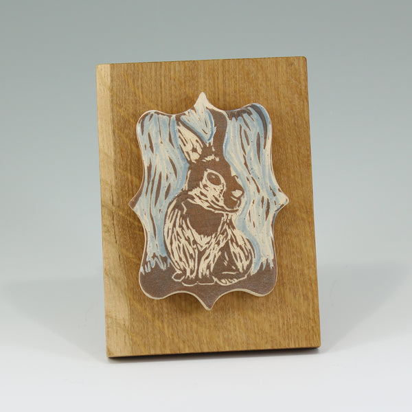 Small sgraffito bunny tile on oak