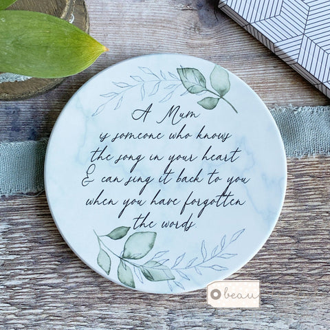 A .... is someone who knows the song in your heart  Quote ceramic Coaster