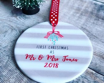 Personalised First Christmas Mr and Mrs Mistletoe Round ceramic decoration