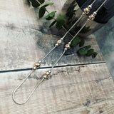 Long rope style necklace with crystal rose gold balls