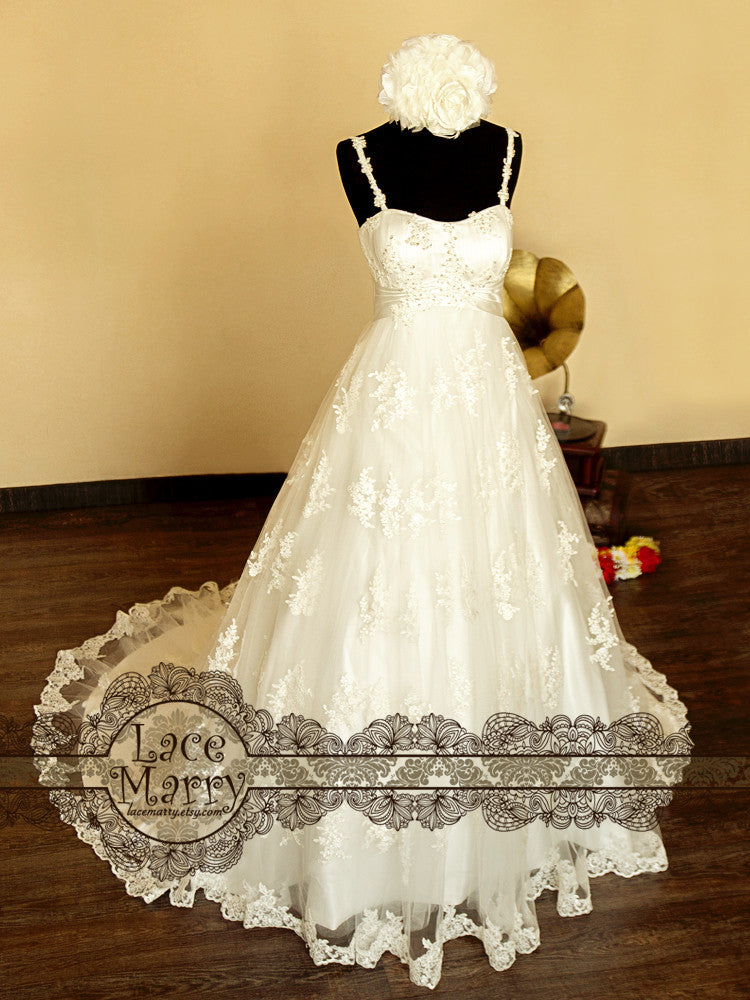 wedding dress with spaghetti straps and flower applique