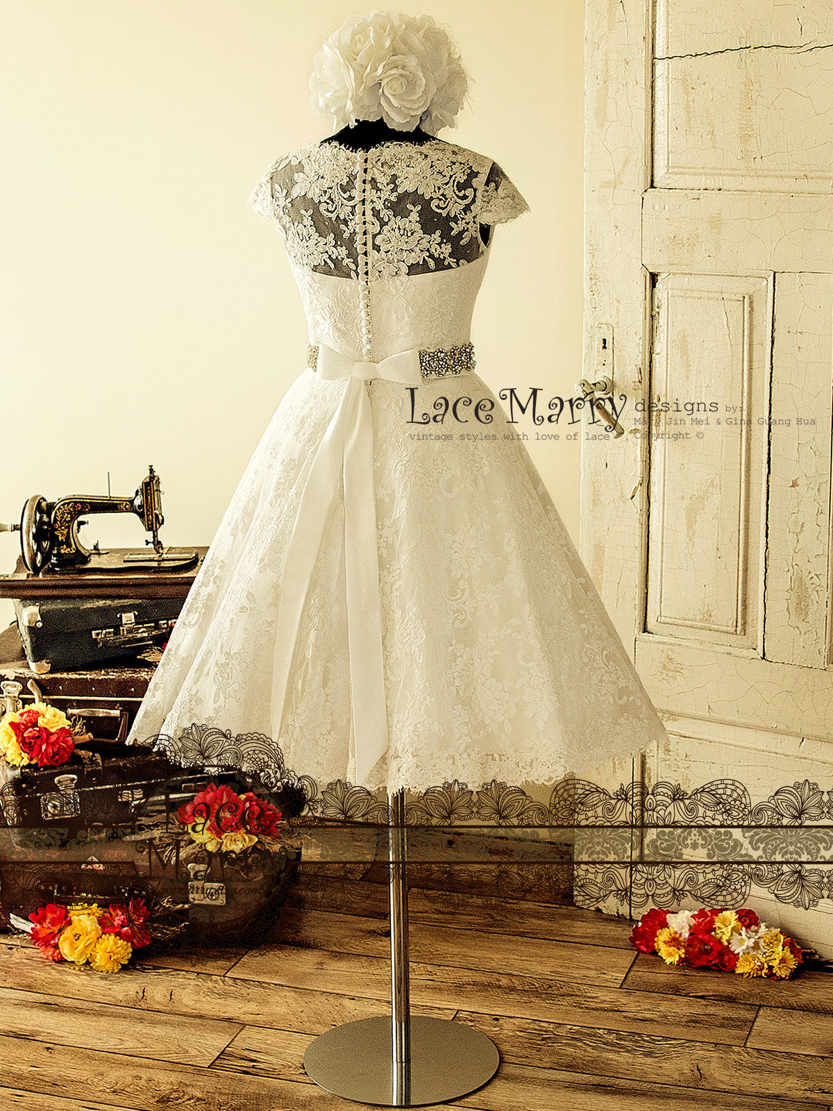1950s Style Wedding Dress From Alencon Lace In Knee Length With Illusion Neckline Cap Sleeves Buttons Beaded Sash And A Line Petticoat