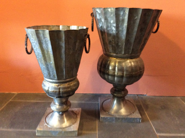 Tall metal urns with handles