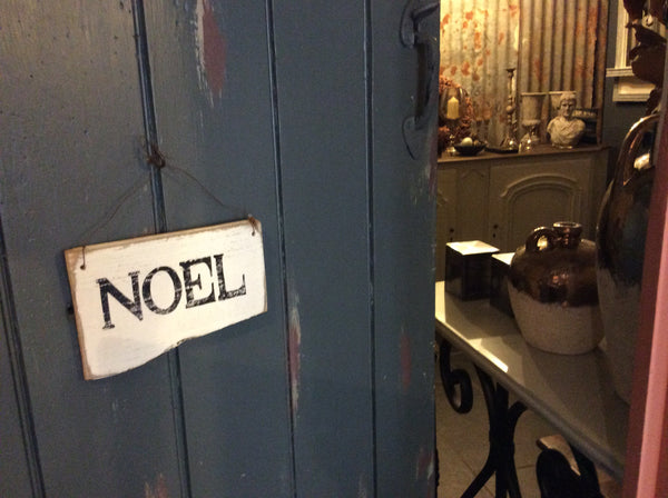 Hand-painted Noel sign