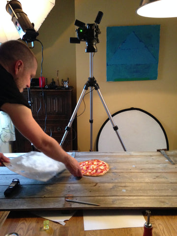 setting up for a pizza shot