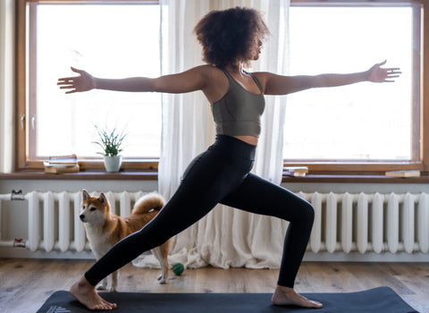 woman with natural hair doing yoga