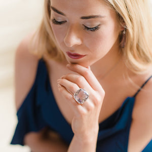 Beautiful model wearing luxury silver amethyst ring