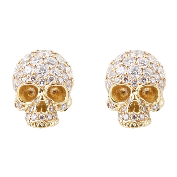 Anthony Lent 18k yellow gold skull studs covered in white pavé diamonds.
