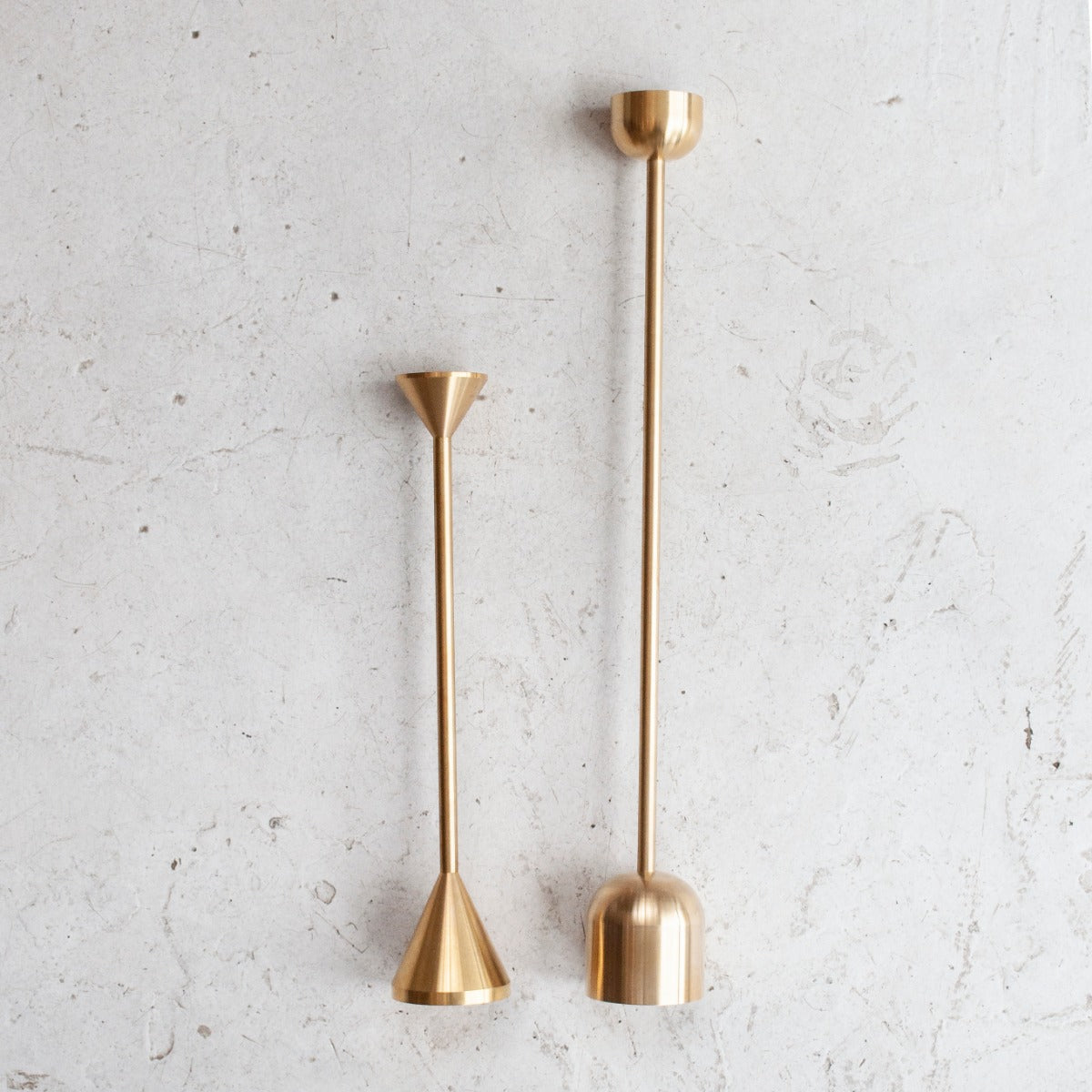 Fort Standard's tall brass candlestick with dome shaped base